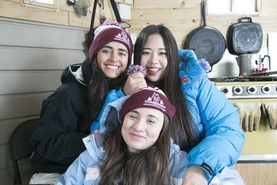 girls in ice fishing shack wearing MVSD hats