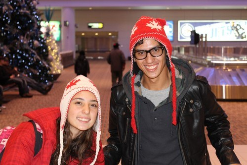 at the airport wearing Canada toques